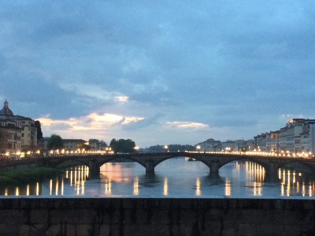 Lights on the River Arno, in Florence, Italy, at night.
