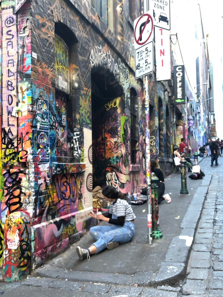 A street artist working in Melbourne, Australia